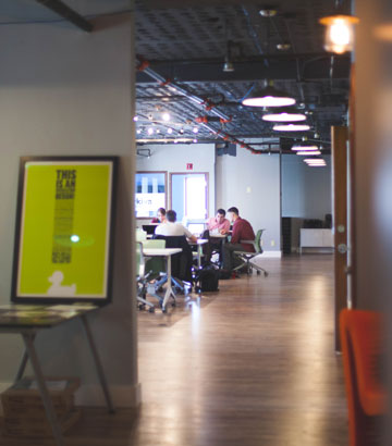 People working tother in an open plan office