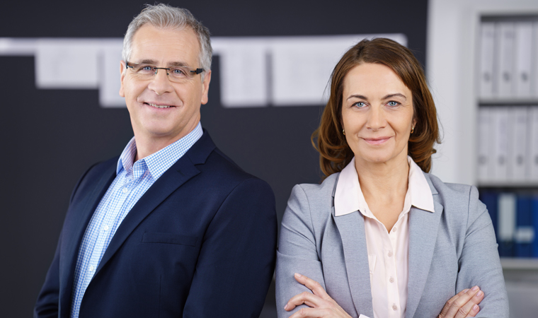 Woman and man in business outfit